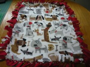 Handmade fleece tie blanket of gray and tan pups for a small pet