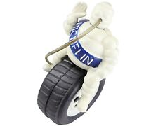 Michelin Man with Pipe Sitting Astride on Tyre - Cast Iron Ornament Figure