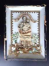Joli ancien reliquaire domestique découpis et tissus