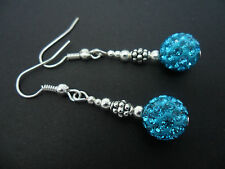 A PAIR OF DANGLY BLUE SHAMBALLA STYLE     EARRINGS.