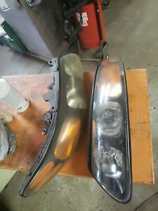 Headlight Set - 2000-2004 Pontiac Bonneville Left/ Right & wires 2Pc USED.