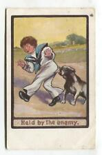 Dog bites boy - 'Held by the Enemy- 1913 used comic postcard