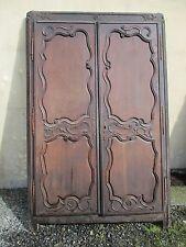 façade placard ancien régence sculpté en chêne provenant d'un manoir.