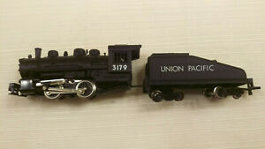 Macao HO Steamer 0-4-0 Union Pacific #3179 runs good. Pulls 10 cars
