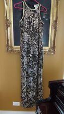 vintage Oleg Cassini 100%silk size 8 black, gold silver bronze long  side slit