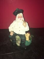 Clothtique Santa Sitting on a Rock Smoking a Pipe with a Bag of Toys