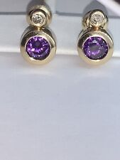 Elegant 14kt gold drop earrings with amethyst and diamond