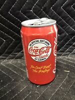 Empty Coca-Cola can The Official Soft Drink Of Summer You Can't Beat The Feeling