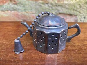 Victorian sterling silver tea infuser.