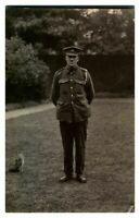 Antique WW1 RPPC postcard portrait of a soldier standing next to a cat kitten