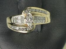 10K YELLOW GOLD DIAMOND ENGAGEMENT RING WITH A MARQUISE SHAPE DIAMOND IN CENTER