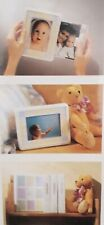 """SHOWBOX, BABY PHOTO VIEWER WHICH HOLDS 40 PHOTOS 4""""X 6"""". EASY PULL/PUSH ACTION"""