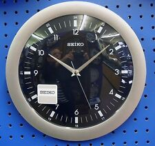 "SEIKO ROUND WALL CLOCK 12"" IN DIAMETER  SILVER SURROUND AND BLACK DIAL QXA137KLH"