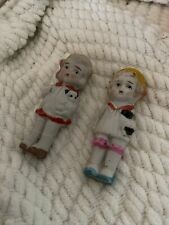 2.- 3inches Tall Frozen Charlotte Dolls