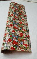 Roll of Christmas Wrapping /Gift Paper Santa Claus Green almost empty vintage