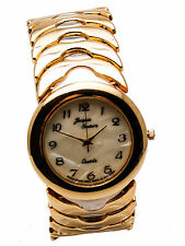 JACQUES COUTURE :WOMEN  GOLD FINISH METAL BAND ROUND CASE ANALOG WATCH