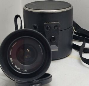Minolta MD f/2.8 28mm Wide Angle Lens with caps and case.