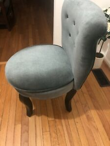 Gray vanity chair with bow on the back of it