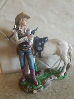 Resin Western Cowgirl guns drawn with her Horse Statue