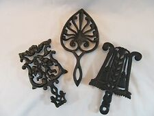 Vintage Lot 0f 3 Black CAST IRON TRIVETS Wilton Cherubs, Broom, Heart