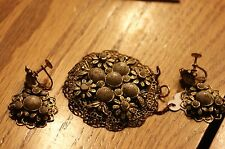 Gold Tone Antique Filagree Pendant and matching earrin with Greyish white stones