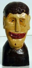 A very folky and unusual folk art carved head and bust of a man.