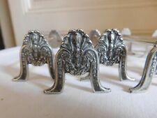 Boulenger suite de 12 porte couteaux métal argenté décor floral laurier coquille