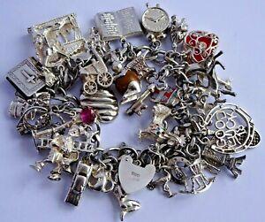 Superb vintage solid silver charm bracelet & 34 rare & interesting charms.104.1g
