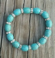 "Simulated Turquoise Stretch Bracelet with Silver Tone Spacers, 7"" - 11"""