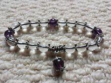 8MM Clear & Amethyst Flex bead Bracelet + Pouch