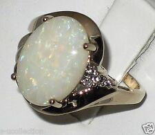 Estate 14k y.gold ring with 10x14mm Opal and Diamond, t.weight 4.50 gram,size 7