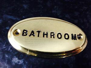 Brass Sign Bathroom