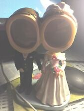 Figurine, Bride & Groom collectible with moving heads & picture frame