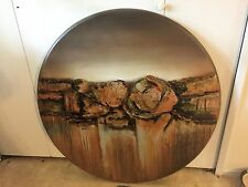 custom oil painting. Its a circle painting with a great color of gold and browns