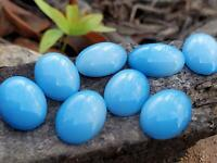 #W35        14X10MM OVAL GLASS BLUE TRANSLUCENT CABOCHONS 12PC