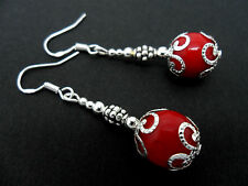 A PAIR OF DANGLY RED CORAL BEAD EARRINGS WITH 925 SOLID SILVER HOOKS. NEW..