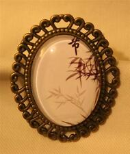 Lovely Swirl Rim Serene Bamboo Shoots Leaves Brasstone Glass Cameo Brooch Pin