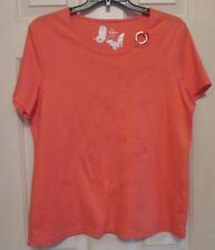 TanJay top size medium short sleeves round neckline with a round ornament on it