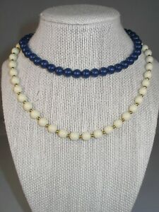 """Two Necklace Lot: Ivory & Gold Tone """"Monet""""  & Navy Single Strand Beads"""