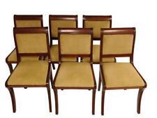 Six side chairs with matching yellow upholstery, scrolled back, rakin. Lot 182