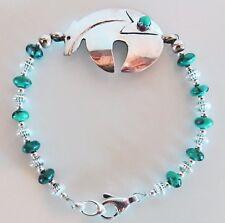 "Sterling silver turquoise bracelet, heartline spirit bear focal, 7 1/2"" x 1 1/8"""