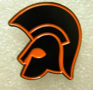 Trojan helmet pin badge. Black and orange design. Ska reggae Mods