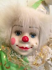 Porcelain Clown Doll in White,Green & Silver  outfit   ON SWING HANGING