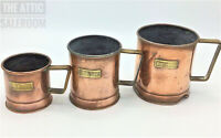 Charming Trio of Antique Victorian Copper & Brass Embossed Grain Measuring Cups