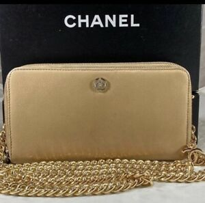 Authentic! CHANEL Neutral Tan Zip Wallet on Chain
