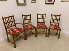 4 MATCHING WOODEN CHAIRS WITH LOVELY RED DECORATED FABRIC