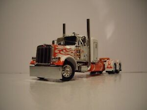 DCP FIRST GEAR 1/64 WHITE WITH ORANGE FLAMES PETERBILT 379 WITH 36'' FT SLEEPER