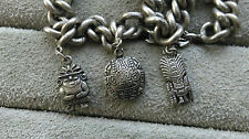 Vintage ethnic charm bracelet with charms, white metal, length is 7.5 inches.