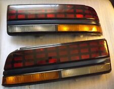OEM 1988-1994 Pontiac Sunfire Tail Light Assemblies # 16508407,16508408
