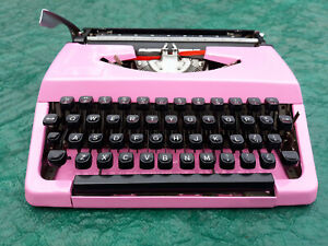 Beautiful bubbelgum pink portable vintage typewriter with case
